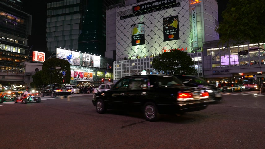 Karts driving on night street, Tokyo, Japan Stock Footage