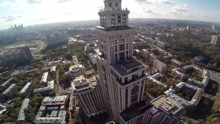 световой люк : Aerial view of highest Moscow Building Triumph-Palace. Exterior of skyscraper Triumph-Palace against megalopolis at sunny day. House is tallest living building in Europe with high 264,5 meters.