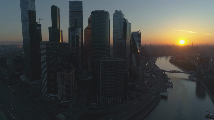 ascend : Moscow City Business Center and Cityscape at Summer Morning. Russia. Aerial View. Drone is Flying Upward. Establishing Reveal Shot