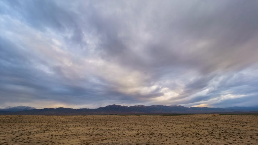 dead valley : Time Lapse of Colorful Clouds in the Evening and Desert with Hills on Background