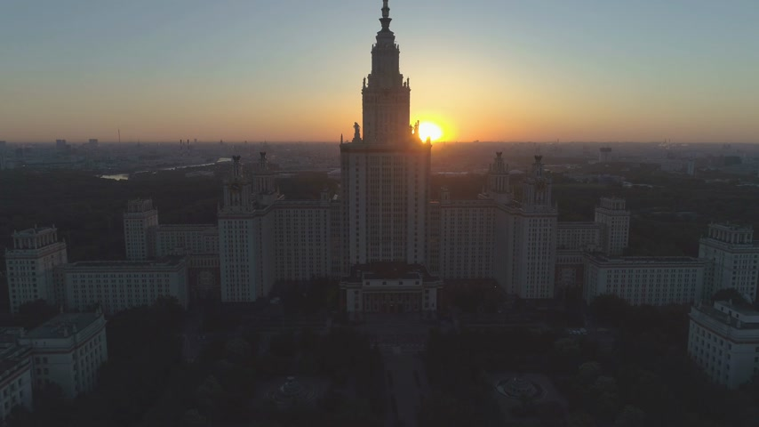 steeples : Moscow State University and City Skyline at Sunrise. Russia. Aerial View. Drone is Flying Upward Stock Footage