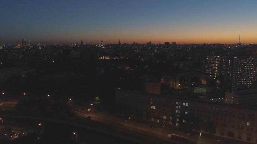 oldalt : Illuminated Moscow Skyline at Evening Twilight. Russia. Aerial View. Drone is Flying Sideways and Upward