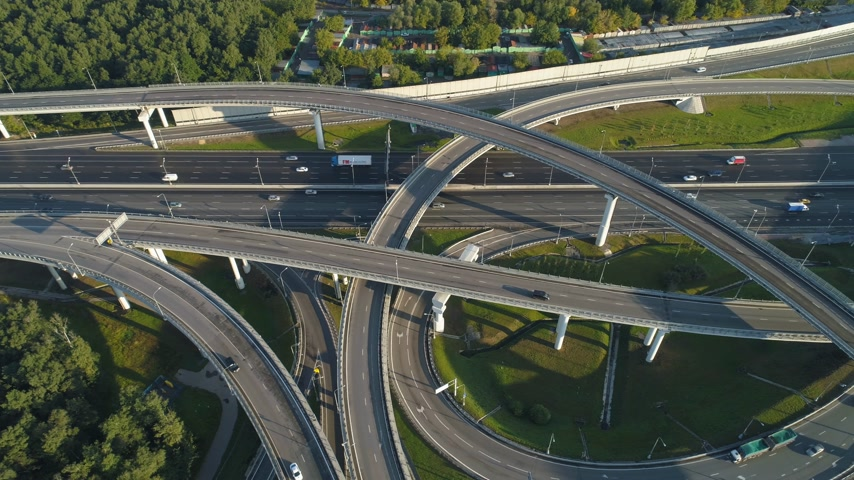 sideways : Multi-level road junction and cars traffic. Drone is flying sideways. Aerial vertical shot
