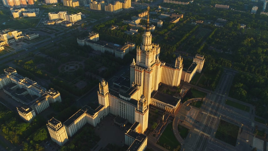 steeples : Flying over Moscow state university main campus in the sunny summer morning. Aerial view. Drone is orbiting around. High altitude shot Stock Footage