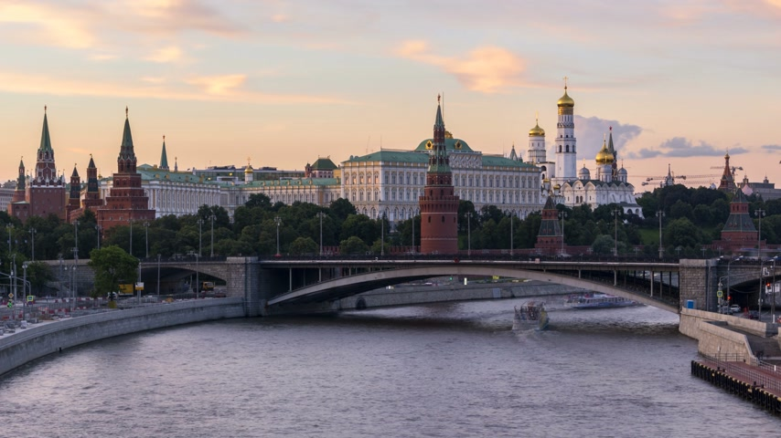 golden time : Moscow Kremlin and Moscow River with ships. Russia. Day to night time lapse in the summer evening