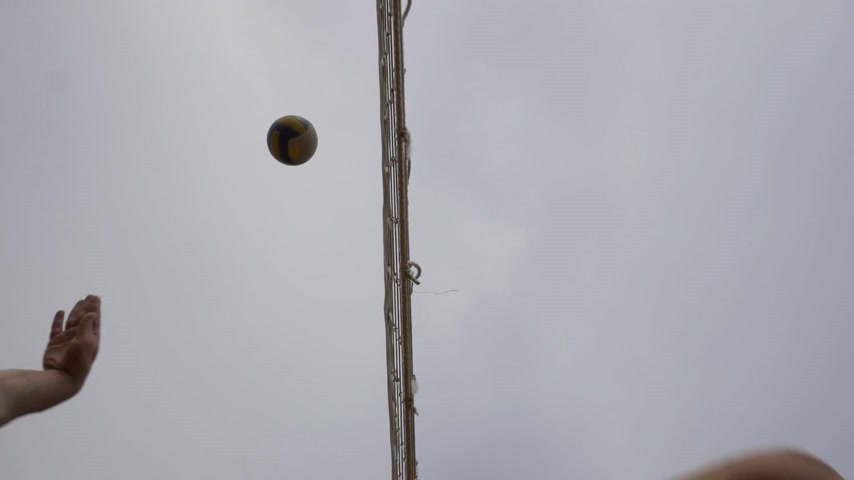 залп : Players are Playing Beach Volleyball. Attack and Block Attempt. Slow Motion. Low Angle Shot