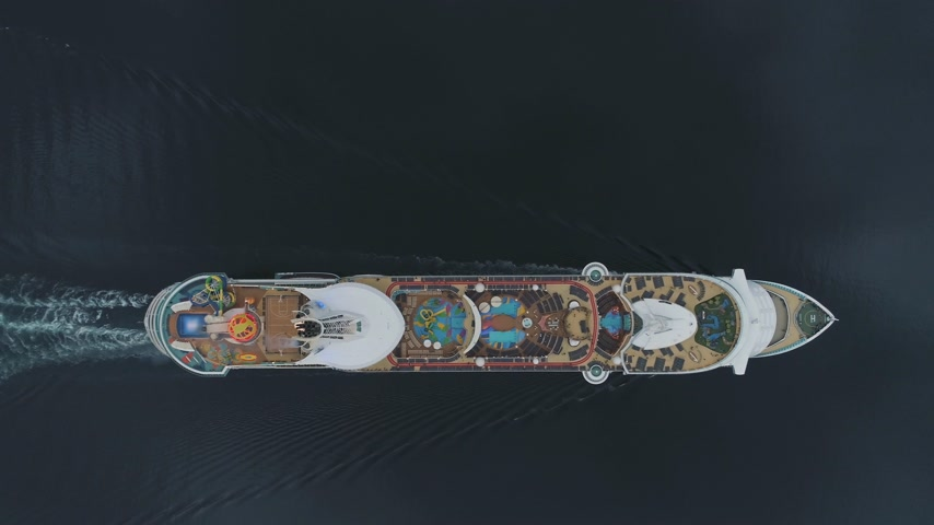 vela : Large Luxury Cruise Liner is Going in Fjord of Norway. Aerial Vertical Top-Down View. Drone is Flying Sideways