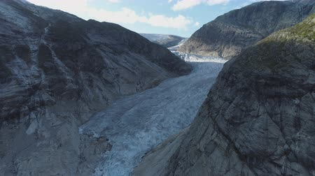 melt : Nigardsbreen Glacier is Arm of Jostedal Glacier in Norway. Aerial View. Drone is Flying Forward