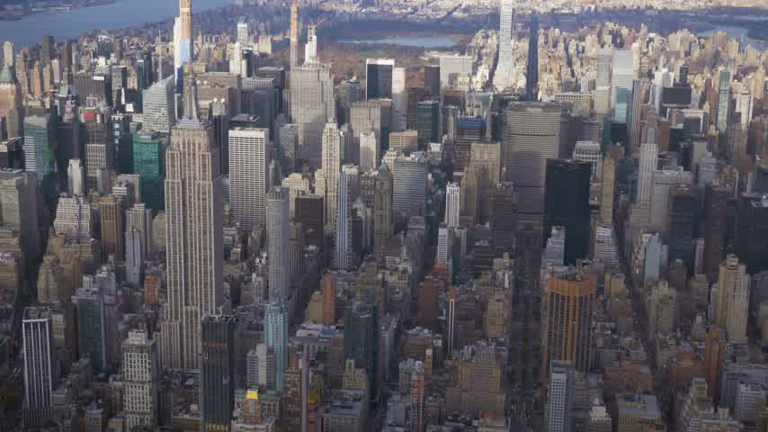 New York City in Summer Day. Midtown Cityscape of Manhattan. United States. Aerial View. Medium Reveal Shot. Camera Tilts Up