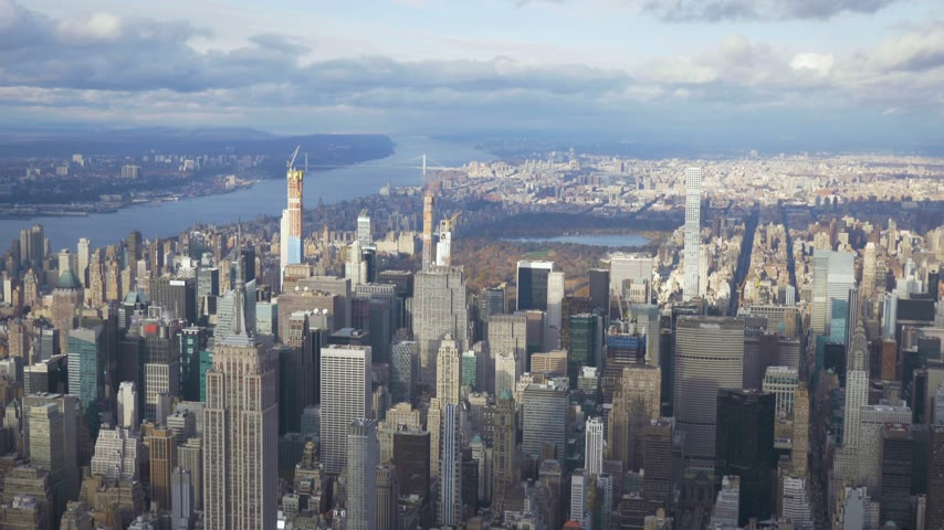 midtown manhattan : New York City in Summer Sunny Day. Midtown Cityscape of Manhattan. United States. Aerial View. Medium Shot. Camera Tilts Down
