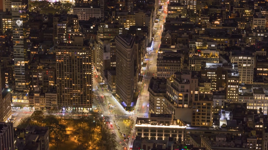 flatiron building : Cityscape of Manhattan with Flatiron Building at Night. New York City, United States of America. Aerial View. Time Lapse