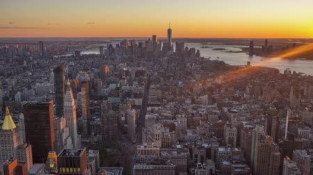 ミッドタウン : Cityscape of Manhattan, New York at Sunset. United States of America. Aerial View. Day to Night Time Lapse
