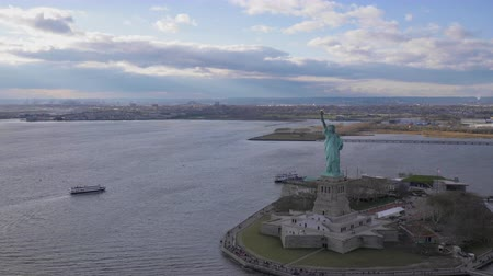 tilt : Statue of Liberty at Cloudy Day. Liberty Island, New York City. Aerial View. Wide Shot. Orbiting