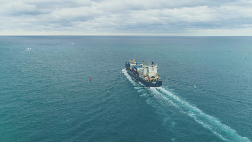 freighter : Cargo Ship with Containers in the Sea. Aerial View. Flying Forward. Establishing Shot