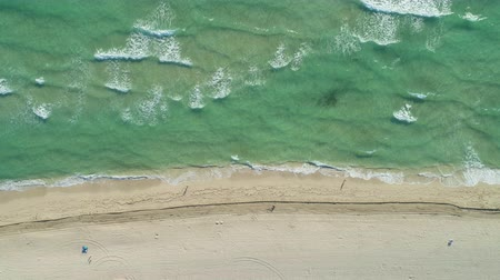 oldalt : Sea and Sandy Beach at Sunny Day. Aerial Vertical Top-Down View. Drone is Flying Sideways Stock mozgókép
