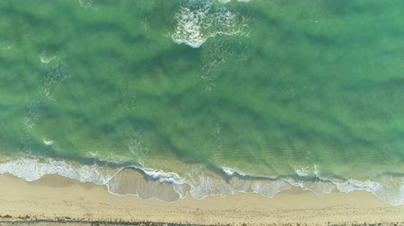 бежевый : Ocean and Sandy Beach in Sunny Morning. Aerial Vertical Top-Down View. Flying Upward Стоковые видеозаписи