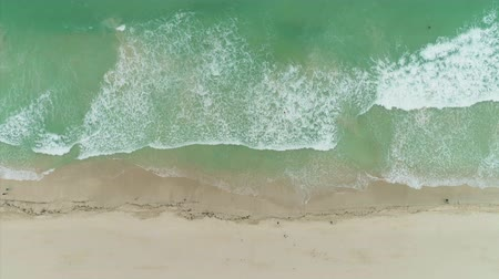 kumlu : Sea with Rolling Waves and Sandy Beach. Aerial Vertical Top-Down View Stok Video