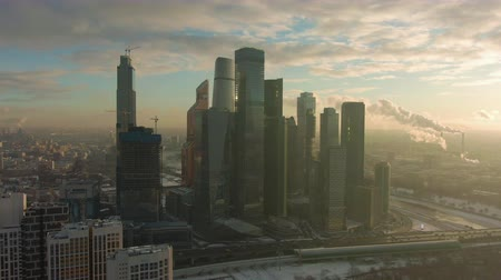 downwards : Skyscrapers of Moscow City Business Center and Urban Skyline in Sunny Winter Morning. Russia. Drone is Orbiting and Descending. Establishing Shot Stock Footage