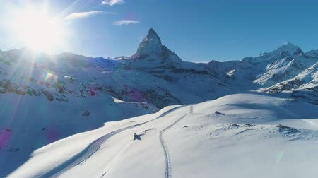 valais : Blue Matterhorn Mountain in Sunny Winter Day. Swiss Alps. Switzerland. Aerial View. Blue Sky. Drone Flies Backwards at Low Level
