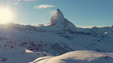 valais : Matterhorn Mountain at Sunset in Winter. Snowy Swiss Alps. Switzerland. Aerial View. Drone Flies Backwards at Low Level