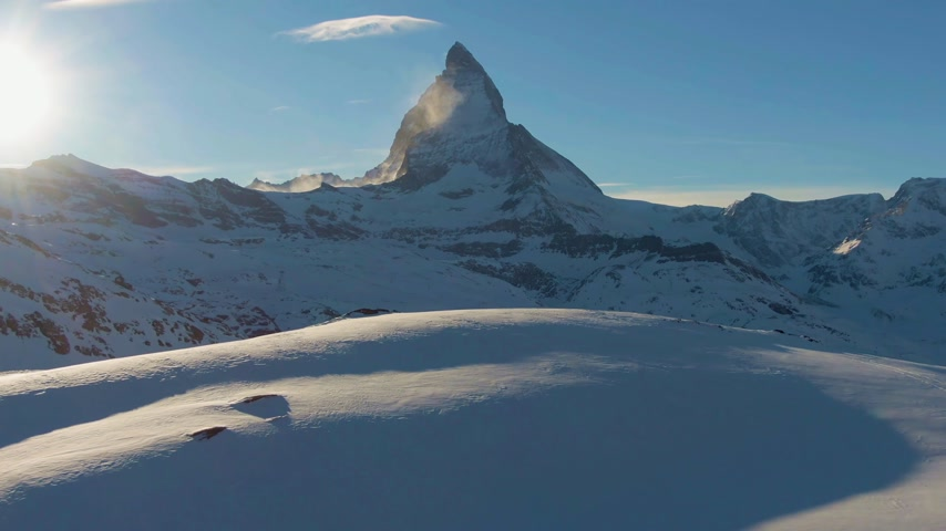 valais : Matterhorn Mountain at Sunset in Winter. Swiss Alps. Switzerland. Aerial View. Drone Flies Forward at Low Level Stock Footage