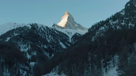 valais : Matterhorn Mountain and Forest in Winter Morning. Swiss Alps. Switzerland. Aerial View. Drone Flies Backwards and Upwards