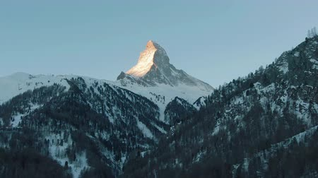 valais : Matterhorn Mountain and Forest in Winter Morning. Swiss Alps. Switzerland. Aerial View. Drone Flies Sideways Stock Footage