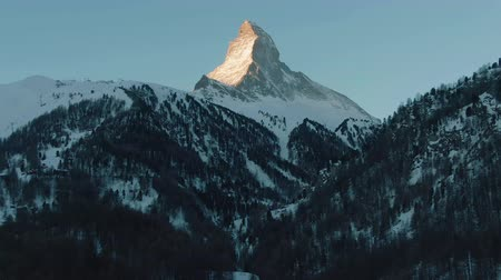valais : Matterhorn Mountain and Forest in Winter Morning. Swiss Alps. Switzerland. Aerial View. Drone Flies Sideways, Camera Tilts Up Stock Footage