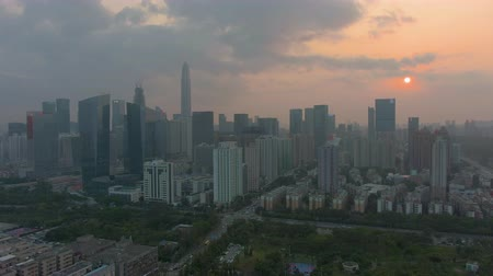 Шэньчжэнь : Shenzhen City at Sunset. Futian District Skyline. China. Aerial View. Drone Flies Backwards and Upwards