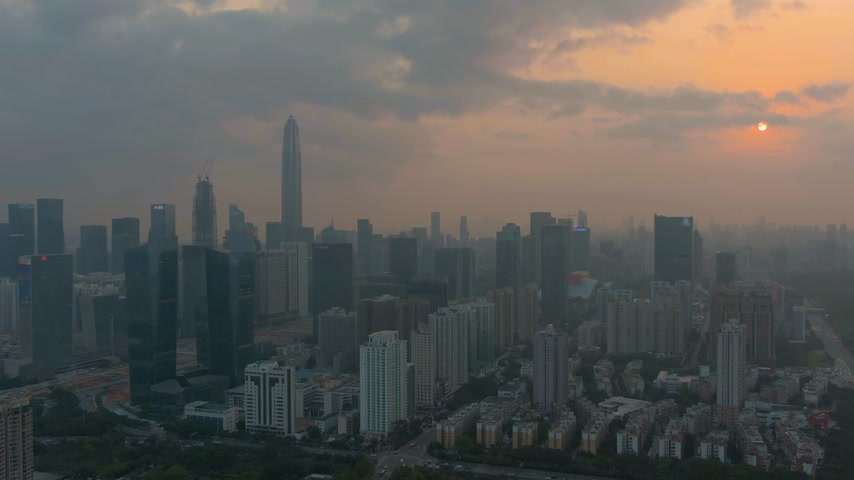 emelkedő : Skyline of Shenzhen City at Sunset. Futian District. China. Aerial View. Drone Flies Forward and Upwards