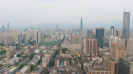 backwards : Shenzhen City. Luohu and Futian District Skyline. China. Aerial View. Drone Flies Backwards and Upwards