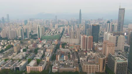 Шэньчжэнь : Shenzhen City at Day. Luohu and Futian District Skyline. China. Aerial View. Drone Flies Forward, Camera Tilts Up, Reveal Shot