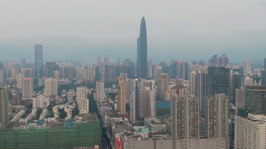 Шэньчжэнь : Shenzhen City at Day. Luohu and Futian District Urban Cityscape. China. Aerial View. Medium Shot. Drone Flies Backwards and Upwards