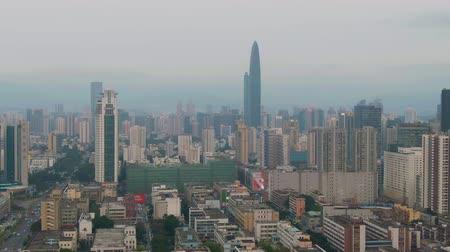 Шэньчжэнь : Shenzhen City. Luohu and Futian District Urban Cityscape. China. Aerial View. Medium Shot. Drone is Orbiting