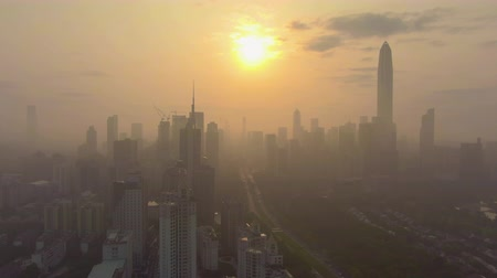 Шэньчжэнь : Shenzhen Silhouette, Urban Skyline in Misty Morning. Skyscrapers of Futian District. China. Aerial View. Drone Flies Backwards and Upwards