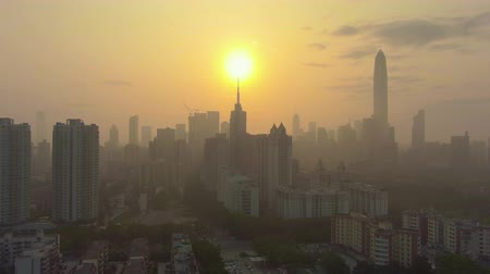 Шэньчжэнь : Shenzhen Urban Skyline at Foggy Sunrise. Skyscrapers of Futian District. China. Aerial View. Drone Flies Upwards
