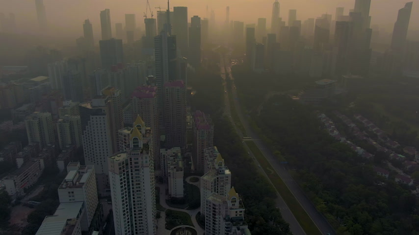 Шэньчжэнь : Shenzhen Urban Cityscape in Misty Morning. Skyscrapers of Futian District. China. Aerial View. Drone Flies Sideways and Upwards, Camera Tilts Up Стоковые видеозаписи