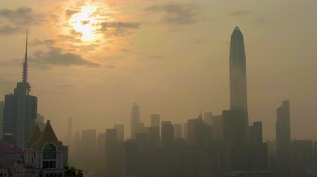 backwards : SHENZHEN, CHINA - MARCH 28, 2019: Skyline at Sunrise. Futian District. Aerial View. Drone Flies Backwards and Downwards