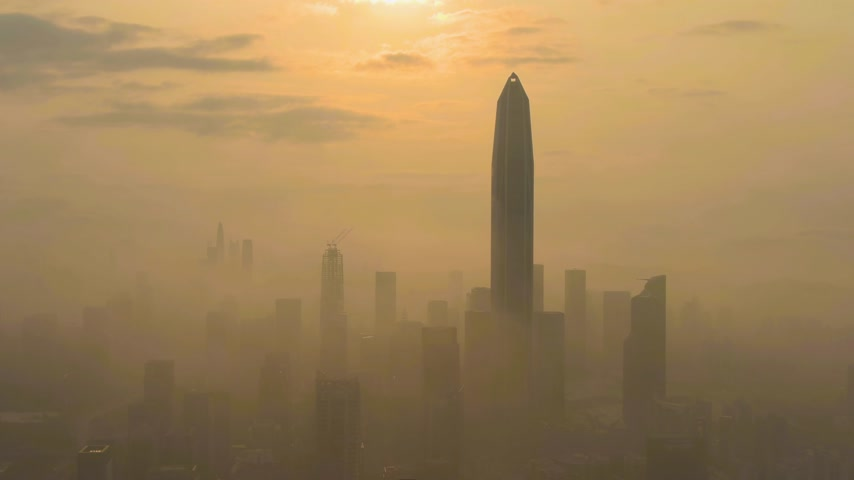 establishing shot : Shenzhen Urban Skyline in Morning in Smog. Skyscrapers of Futian District. China. Aerial View. Drone is Orbiting