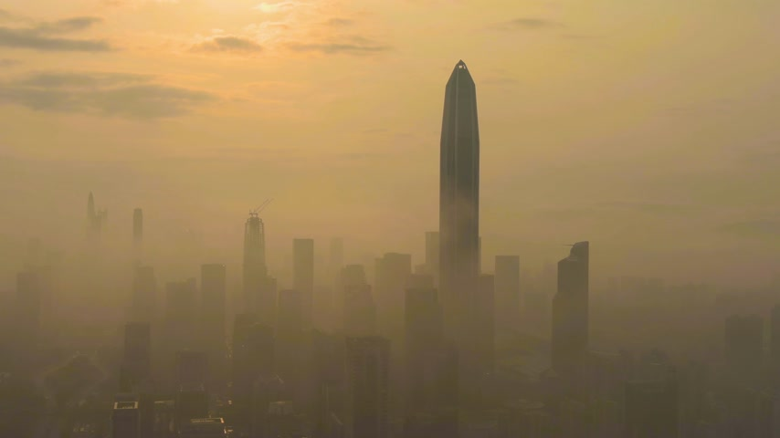 establishing shot : Shenzhen Urban Cityscape in Morning in Smog. Skyscrapers of Futian District. China. Aerial View. Drone is Orbiting