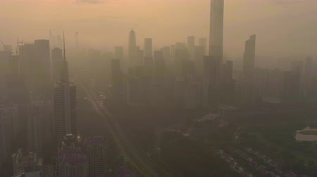 Шэньчжэнь : Shenzhen Skyline in Morning in Smog. Skyscrapers of Futian District. China. Aerial View. Drone Flies Forward, Reveal Shot