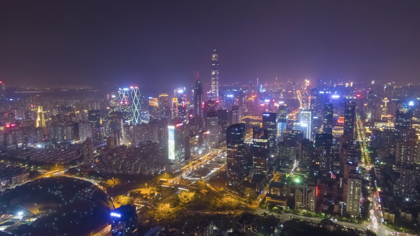 downwards : Shenzhen Urban Cityscape at Night. Skyscrapers of Futian District. China. Aerial Time Lapse, Hyper Lapse. Drone Flies Forward and Downwards Stock Footage