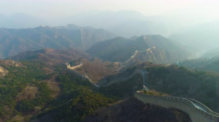downwards : Great Wall of China and Green Mountains. Aerial Drone Shot. Flying Backwards and Downwards Stock Footage