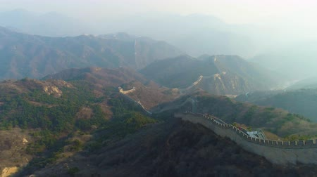 downwards : Great Wall of China and Green Mountains in Sunny Day. Aerial View. Drone Flies Forward and Downwards