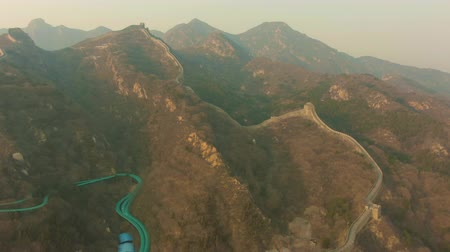 downwards : Great Wall of China at Sunny Evening in Haze. Badaling. Aerial View. Drone Flies Forward and Downwards Stock Footage