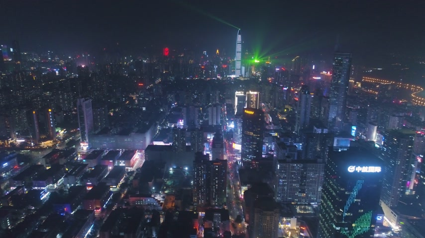 Шэньчжэнь : SHENZHEN, CHINA - MARCH 27, 2019: City at Night. Futian and Luohu District. China. Aerial View. Drone Flies Sideways and Upwards