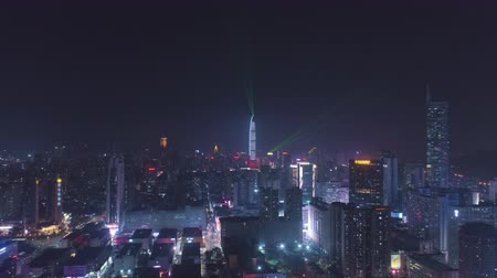 Шэньчжэнь : Shenzhen Urban Skyline at Night. Futian and Luohu District. China. Aerial View. Drone Flies Backwards and Upwards