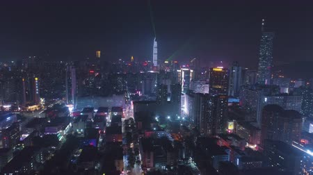 Шэньчжэнь : Shenzhen Urban Cityscape at Night. Futian and Luohu District. China. Aerial View. Drone Flies Forward, Tilt Up. Reveal Shot