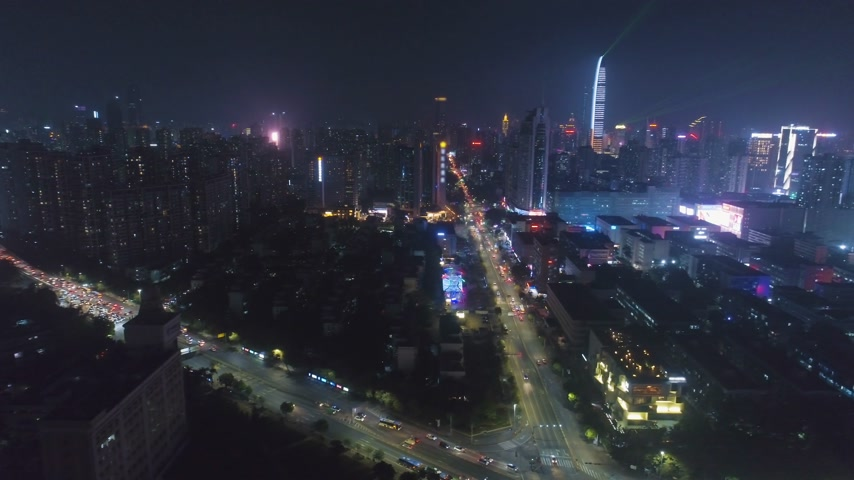 körképszerű : Illuminated Shenzhen City at Night. Futian and Luohu District. China. Aerial View. Drone Flies Sideways and Upwards