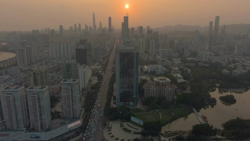 Шэньчжэнь : Shenzhen City at Sunset. China. Aerial View. Drone Flies Forward, Tilt Up. Reveal Shot